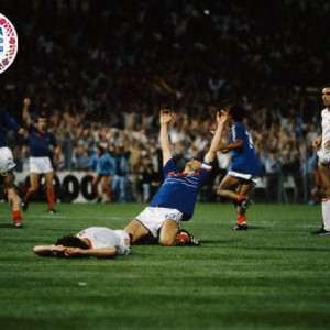 23 Jun 1984, Marseilles, France --- France's captain Michel Platini celebrates after scoring the final goal in overtime of the semi-finals of the 1984 UEFA Euro against Portugal. --- Image by © Gerard Rancinan; Pascal Kyriazis/Sygma/Corbis